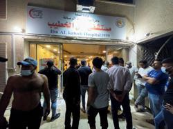 Fire from oxygen tank blast in Baghdad COVID-19 hospital kills 82
