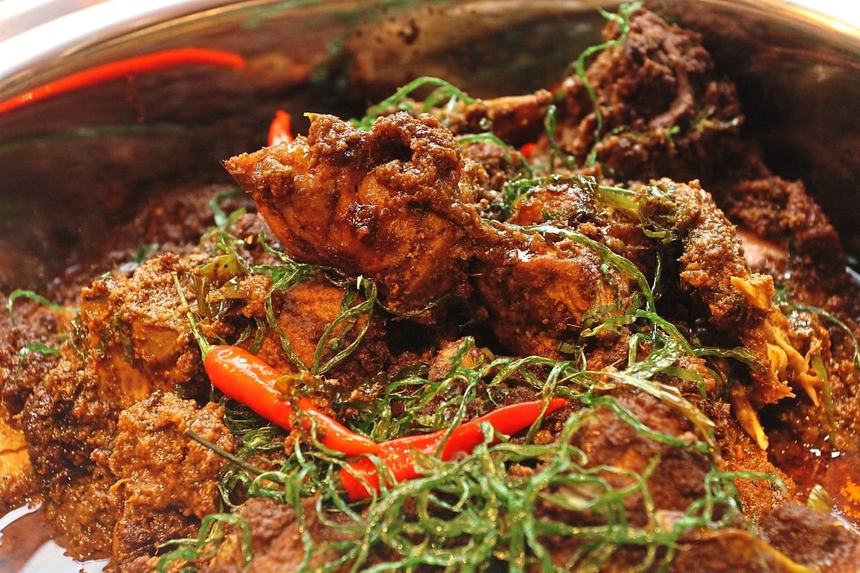 Ayam Minang is braised chicken with spices, coconut milk, lemongrass and turmeric leaves.