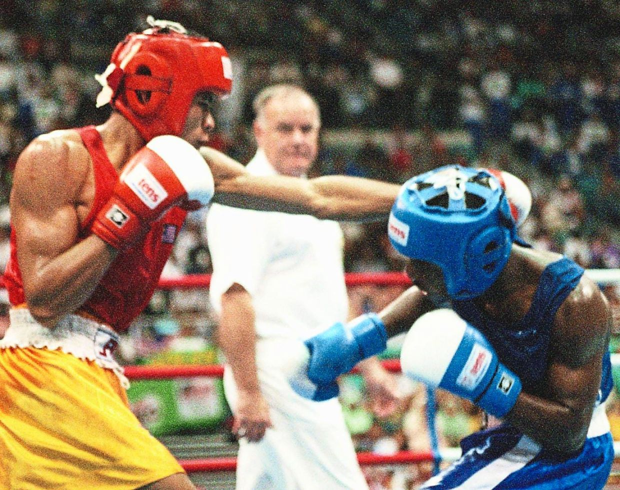 Sapok in his Army uniform; and Sapok (in red) taking on Moses in the final.