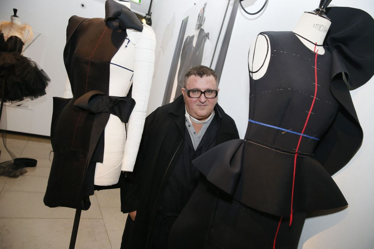 Alber Elbaz poses during the exhibition 'Manifesto' dedicated to his work in 2015. Photo: AFP