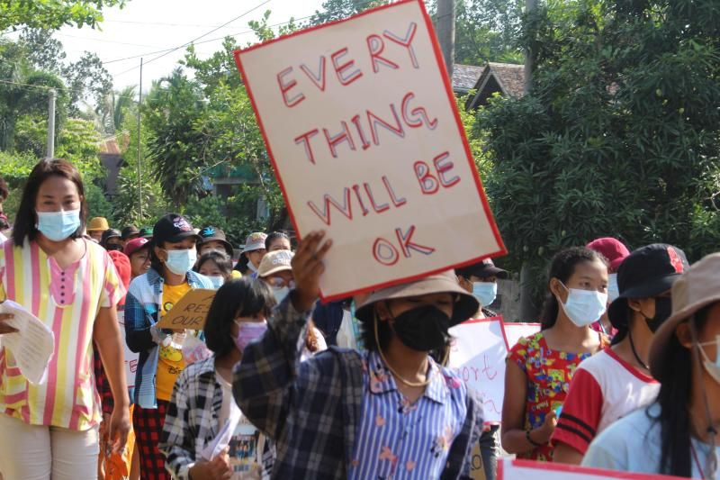This photo taken and released by Dawei Watch on April 26, 2021 shows a protester holding a sign during a demonstration against the military coup in Pandale village in Dawei's Launglone township. - AFP