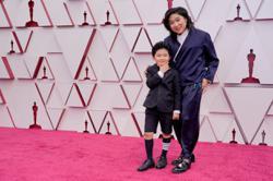 Red carpet makes a comeback at history-making Oscars
