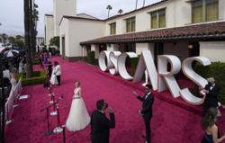 Oscars 2021: See photos of stars attending the Academy Awards around the world
