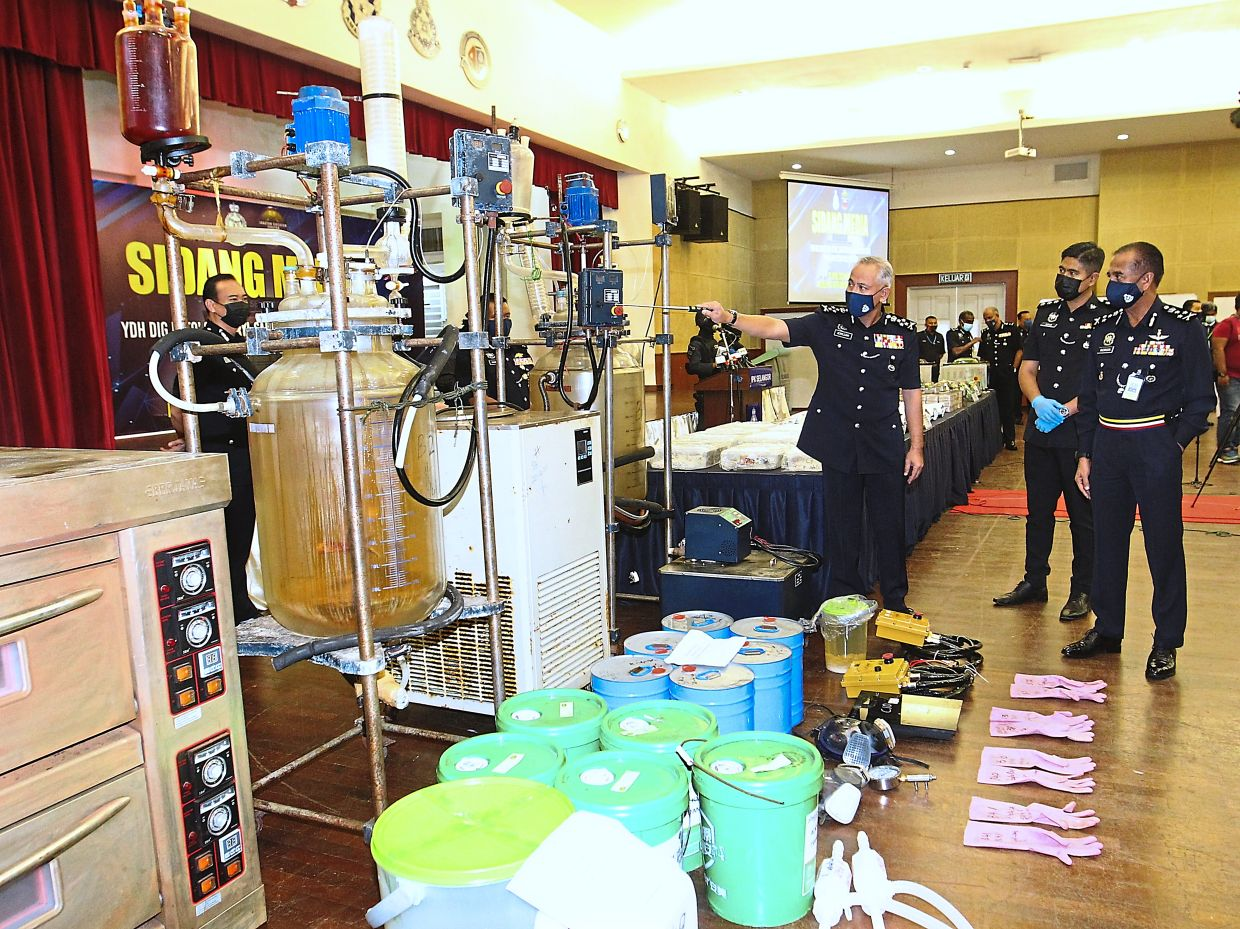 Crippled: Acryl Sani showing some of the items seized at the state police headquarters in Shah Alam, Selangor.