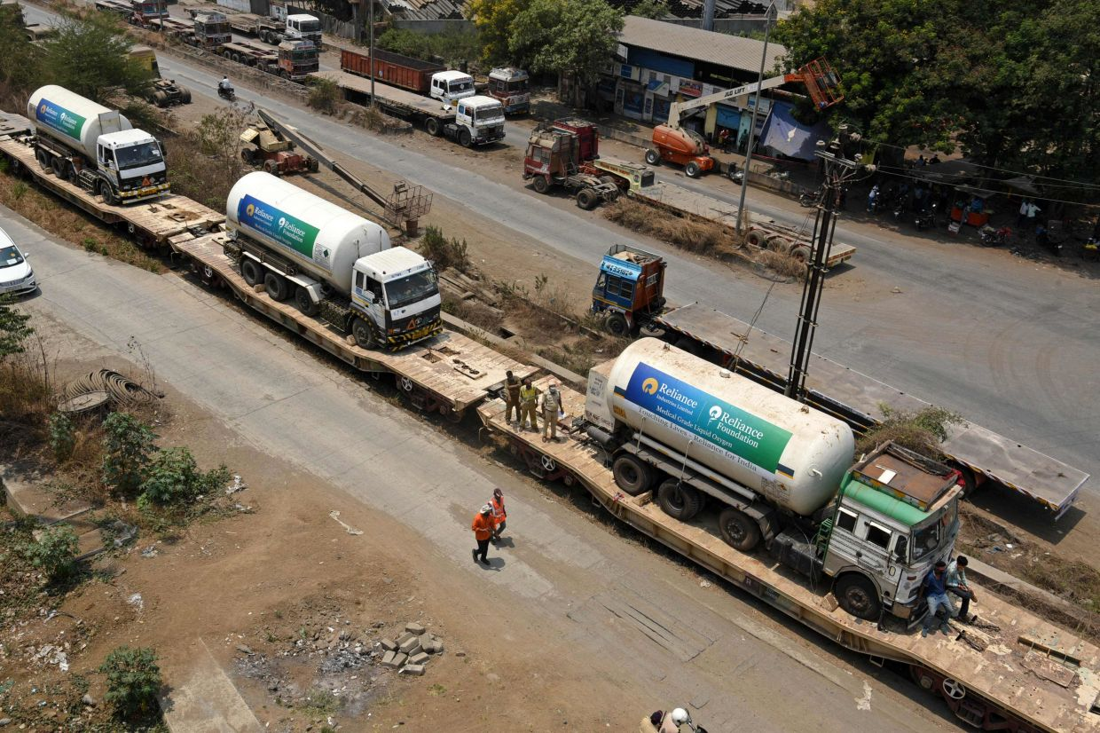 Oxygen tankers are seen on a special train 'Oxygen Express' upon their arrival at a goods yard amid Covid-19 coronavirus pandemic in Navi Mumbai. Photo: AFP