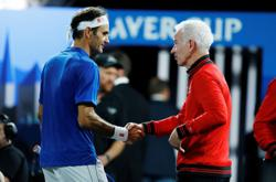 Federer playing French Open with eye on Wimbledon - McEnroe