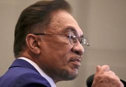 Anwar arrives at Bukit Aman to have statement taken about viral audio clip