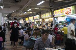 Crunchtime for cash at Singapores famed hawker food stalls