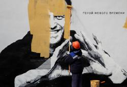 Russian authorities paint over large Navalny mural in St Petersburg