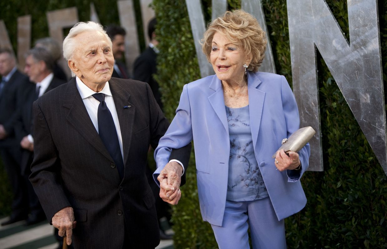 In this file photo taken on February 26, 2012 Kirk Douglas and his wife Ann arrive to the Vanity Fair Oscar Party at the Sunset Tower in West Hollywood, California. Photo: AFP