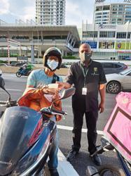 Neighbourhood mall treats food delivery riders to bubur lambuk