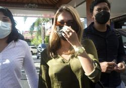 Two influencers ordered off Bali after fake mask video prank