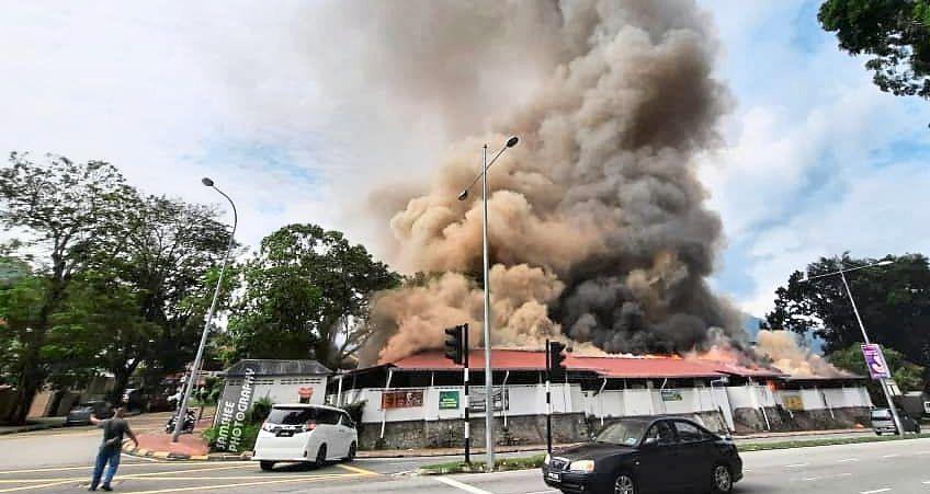 Smoke billowing from Mutiara Selera food court in the incident last November. — Social media pic