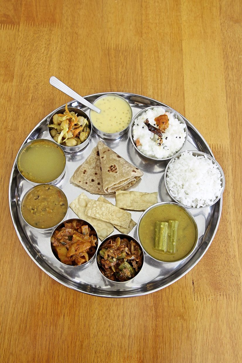 A full Chettinad  meal plated from  the buffet line.