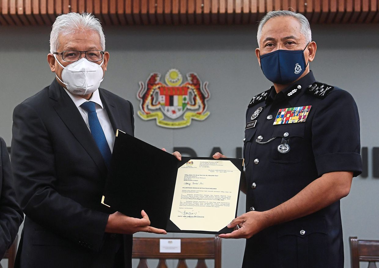 It's official: Hamzah (left) handing over the letter of appointment to Acryl Sani at a special press conference at the Home Ministry. — Bernama