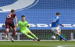 Soccer-Brighton beat Leeds to all but secure Premier League safety