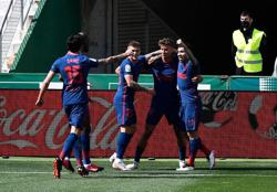 Soccer-Atletico ride luck to win after late Elche penalty miss