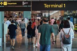 Singapore official who cleared airport arrivals now ill with Covid-19