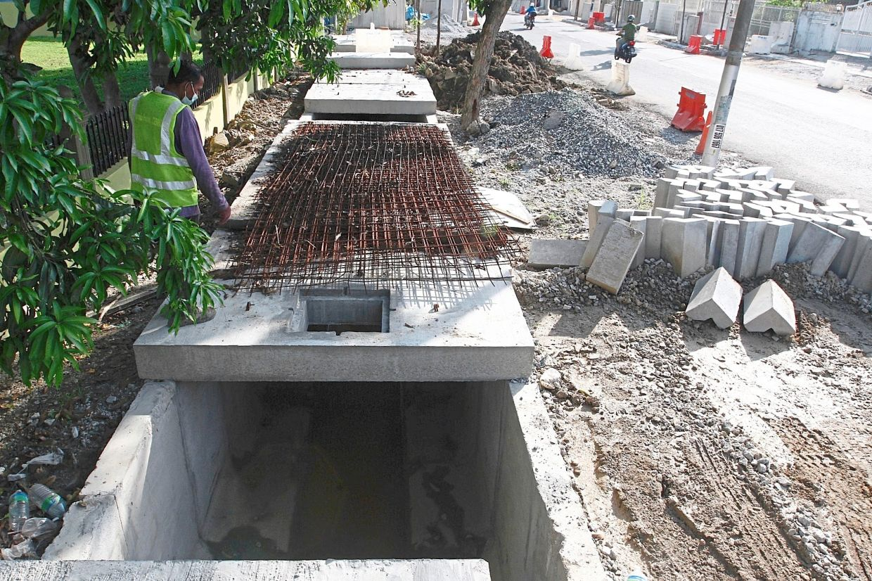 The flood mitigation project involves the widening of most drains by over twofold in Jalan P. Ramlee.