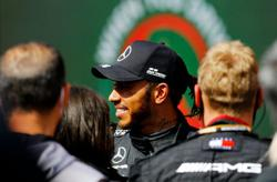 Motor racing-Hamilton goes eight points clear with victory in Portugal