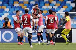 Soccer-Nandez snatches valuable draw at the death for Cagliari against Napoli