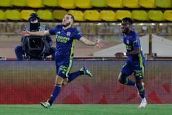 Soccer-Cherki late goal earns Lyon 3-2 win at Monaco