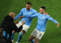 Soccer-Man City players must stay calm to finish off PSG, says Guardiola