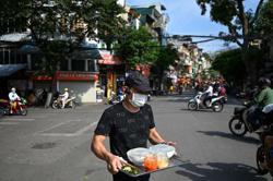 Hanoi and Ho Chih Minh City suspend non-essential amid Covid-19
