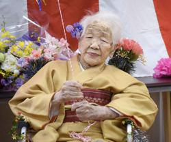 Olympics-World's oldest person pulls out of torch relay