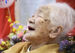 Olympics: World's oldest person pulls out of torch relay