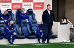 Soccer-Koeman touchline ban upheld, misses Atletico game