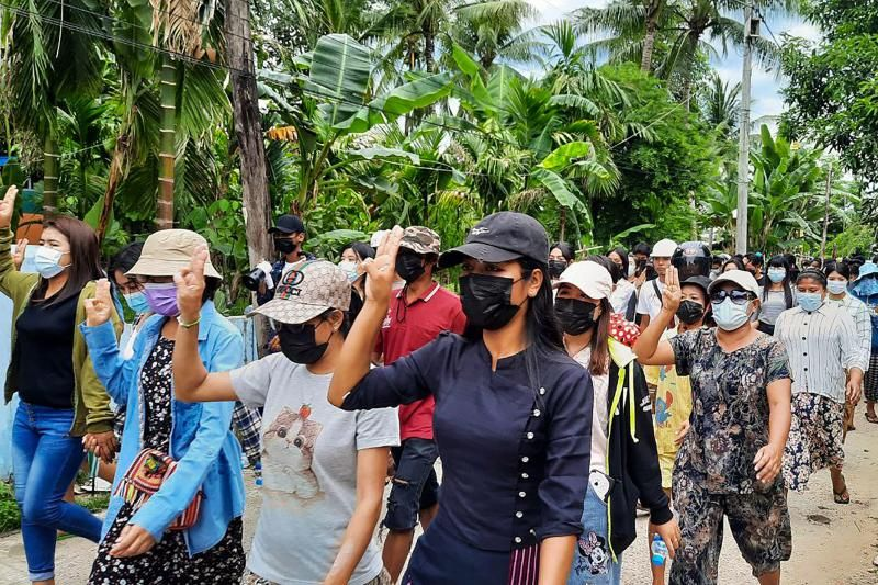 This handout photo taken and released by Dawei Watch on May 6, 2021 shows protesters making the three-finger salute during a demonstration against the military coup in Dawei. - AFP