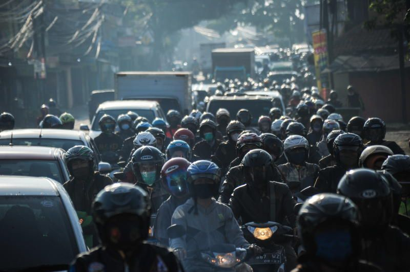 People ride motorcycles on the first day of a national travel ban as Indonesia halts sea, land, air, and rail travel from May 6 to 17 for the Eid al-Fitr celebrations in an effort to prevent a large-scale transmission of the coronavirus disease (COVID-19) pandemic in Bandung, West Java Province, Indonesia May 6, 2021, in this photo taken by Antara Foto via Reuters.