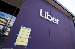 Uber narrows loss on food-delivery growth, cost cuts, but ride-hail demand flat