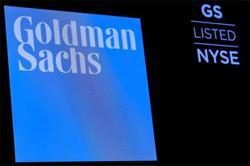Dow ends at record high, Nasdaq falls as tech slides