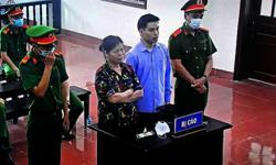 Vietnam jails mother and son for spreading news of deadly land dispute
