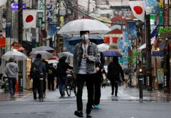 Tokyo governor backs extended state of emergency to contain COVID-19 surge