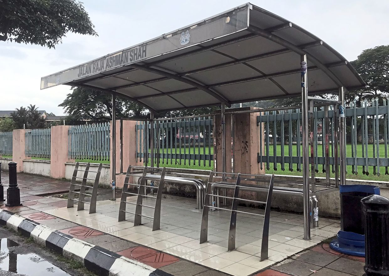 Commuters want the seats at bus stops like this one in Jalan Raja Ashman Shah to be replaced with something more comfortable.