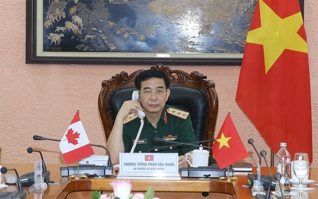 Vietnam strengthens defence relations with Canada and Laos