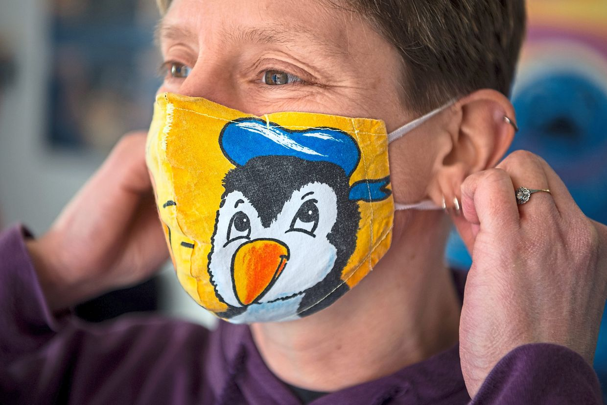 Even in a pandemic, it has to be penguin-themed: Berends putting on her face mask.