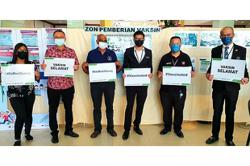 Sabah journalists get in line for their jabs