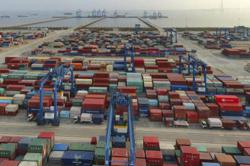 China's trade surges on strong global demand, commodity boom