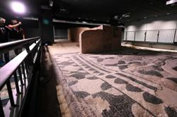 Ancient Roman 'domus' with mosaic floors tucked under modern flats in Rome