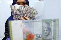 Ringgit closes higher vs US dollar