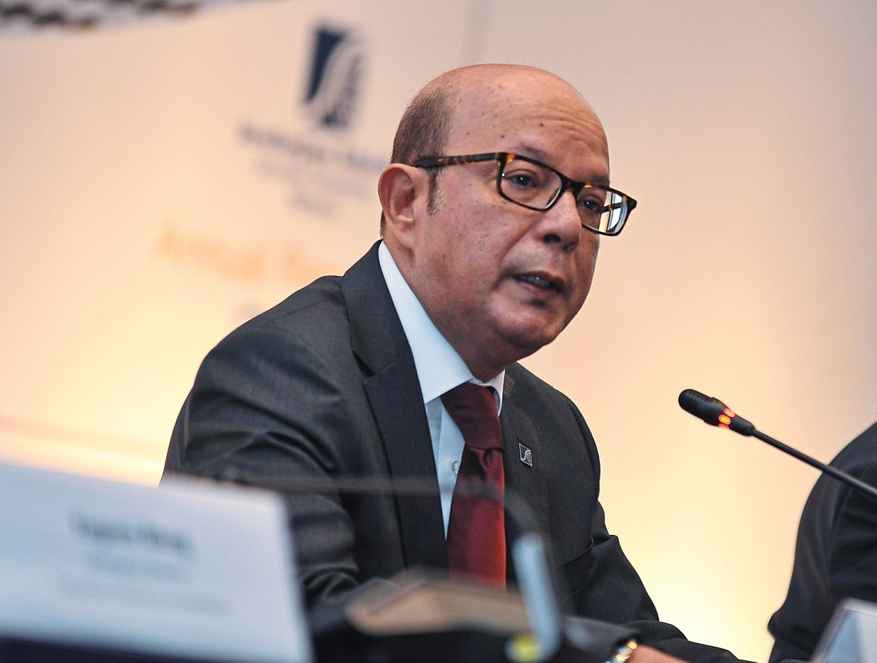 Last May, SC chairman Datuk Syed Zaid Albar announced that Malaysians can buy financial products via e-wallet and e-payment platforms. — AFIQUE YUSOFF/The Star