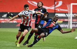 Soccer-Palace secure top-flight status with 2-0 win at Sheffield Utd
