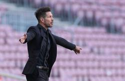 Soccer-Simeone says he won't watch title rivals Real's match after Atleti draw with Barca