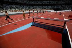 Olympics-Gatlin wins at Tokyo Olympic Stadium test event