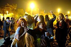 Spaniards party as COVID curfew ends but doubts remain