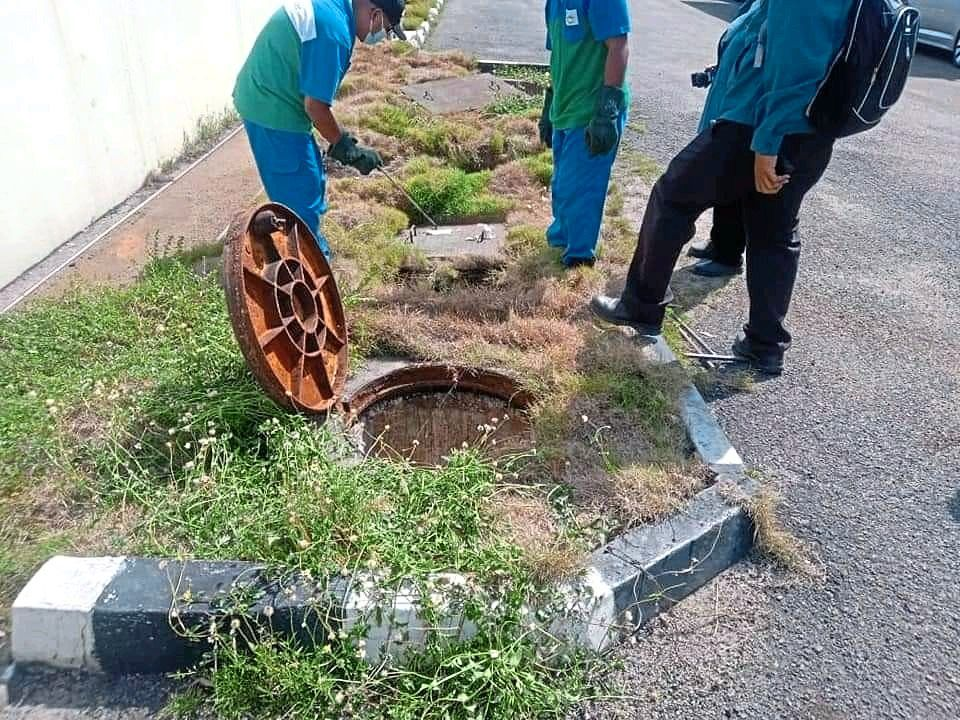 SPAN officers checking on a manhole that had hazardous waste dumped into it.